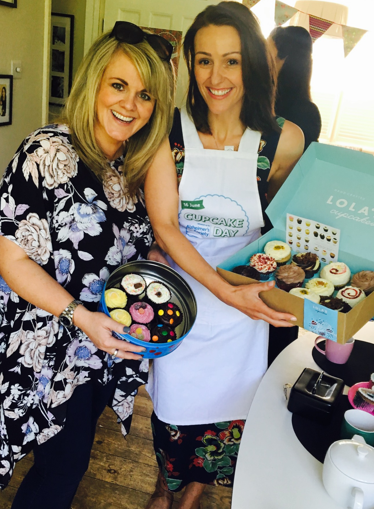 """Suranne Jones and Sally Lindsay display cupcakes on sale at Surannes  Cupcake Day party """""""